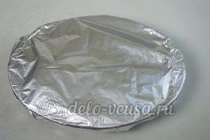 Запеченный картофель с ребрышками: Накрываем блюдо фольгой и отправляем в духовку