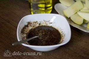 Курица, запеченная с яблоками в духовке: Соединить специи с маслом