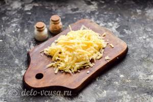 Запекаем под фольгой 30 минут, затем снимаем фольгу и посыпав блюдо тертым сыром отправляем в духовку на 10-15 минут